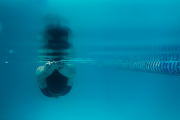 Front view of swimmer diving