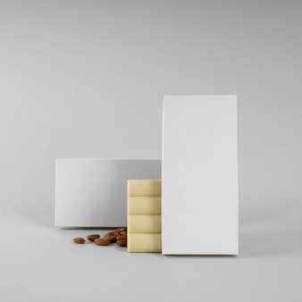 Front view of tablet of  whit chocolate packaging with nuts