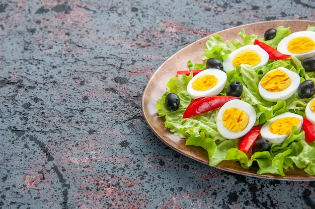 Front view tasty egg salad with green salad and olives on light background