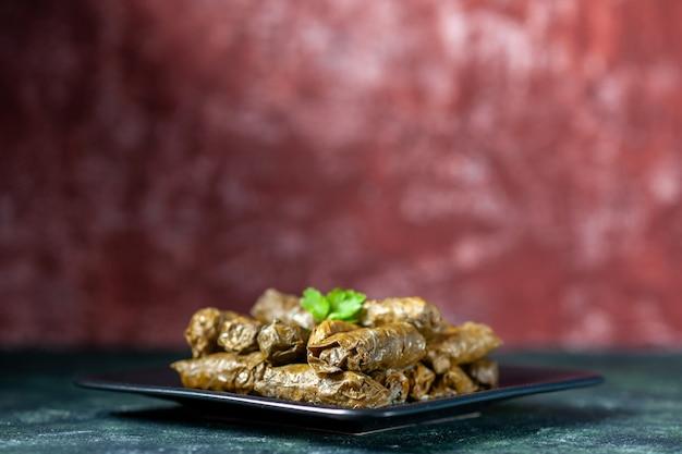 Front view tasty leaf dolma inside plate on dark background calorie oil dinner food restaurant meal salad dish meat