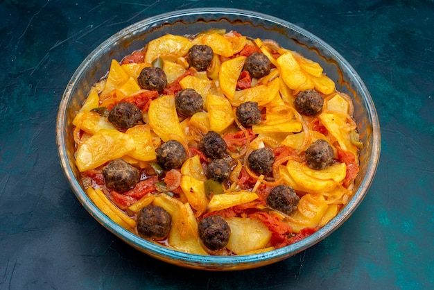 Front view tasty potato meal with meatballs and tomatoes on dark-blue background.