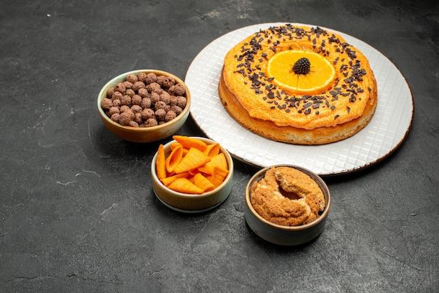 Front view tasty sweet pie with orange slices on dark grey desk sweet pie dessert tea biscuit cake sugar