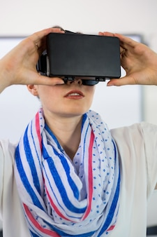 Front view of teacher using virtual reality headset