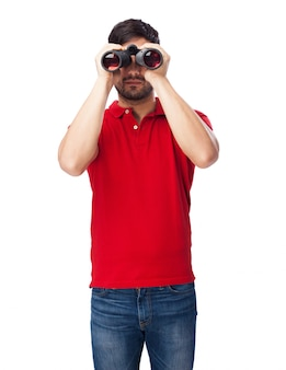 Front view of teen holding his binoculars