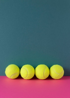 Front view of tennis balls with copy space