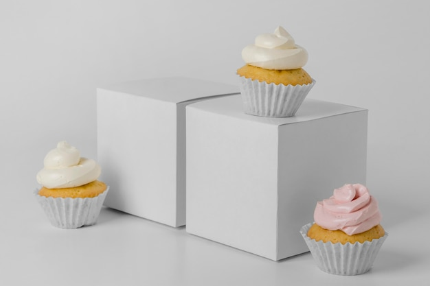 Front view of three cupcakes with packaging box