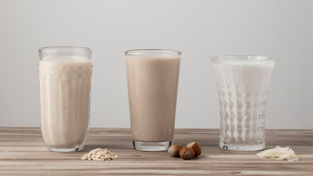 Front view of three glasses of different milk