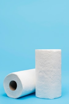 Front view of toilet paper rolls with copy space