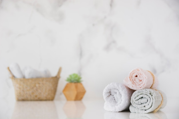 Front view towels set with basket on table