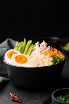 Front view of traditional asian dish with noodles and eggs