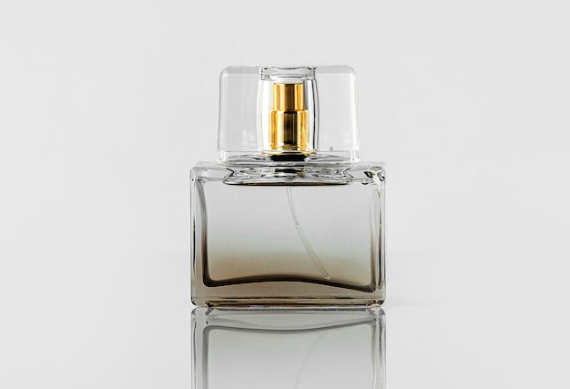 A front view transparent bottle fragrance isolated on the white wall