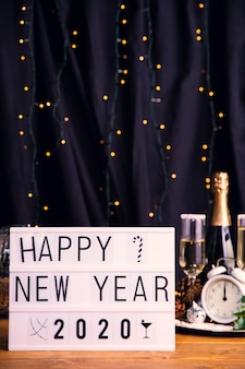 Front view tray with drinks and sign for new year