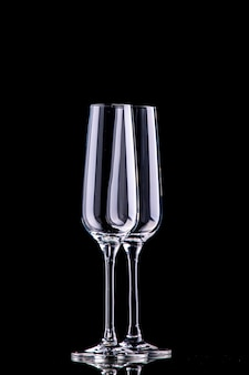 Front view two champagne glasses on black surface