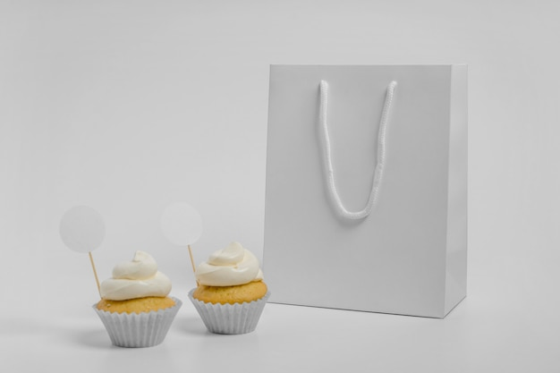 Front view of two cupcakes with packaging bag