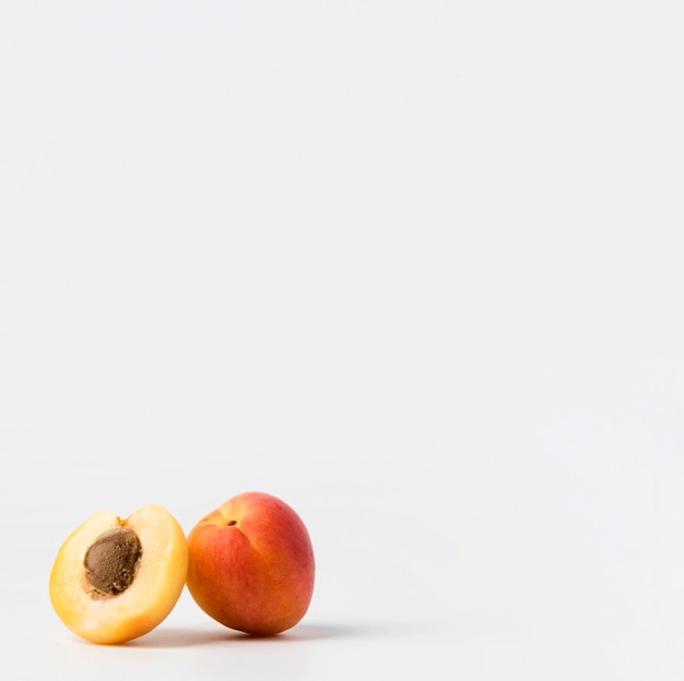 Front view of two peaches with copy space