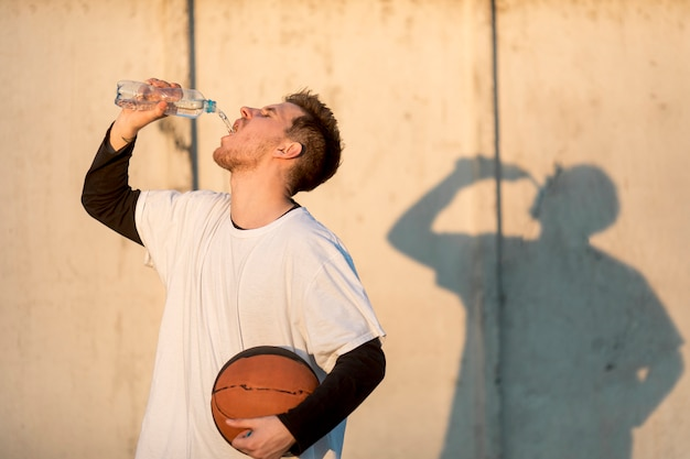 Front view urban basketball player hydrating