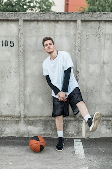 Front view urban basketball player posing