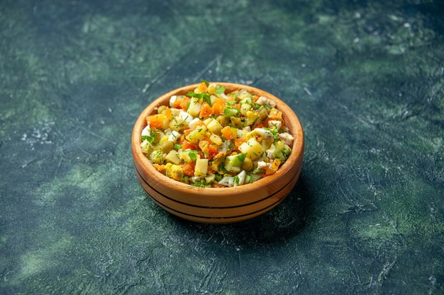 Front view vegetable salad from boiled vegetables mixed inside round plate on dark background