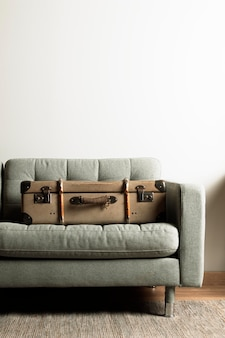 Front view vintage suitcase on sofa