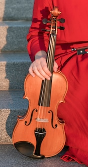 Front view of violin held by woman