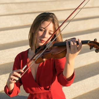 Front view of violinist playing on steps