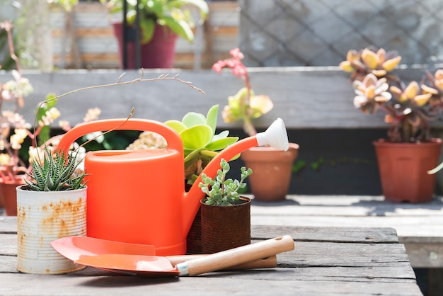 Front view watering can on wooden tabl