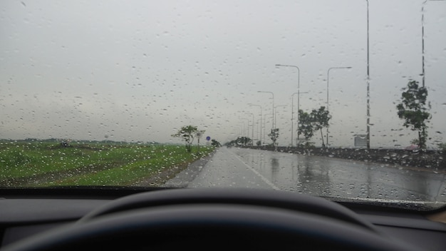 Front view while driving on the highway. under heavy rain and storms.