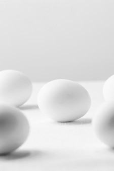 Front view white chicken eggs on table