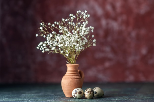 Front view white flowers with quail eggs on a dark background beauty tree branch color photo nature food bird