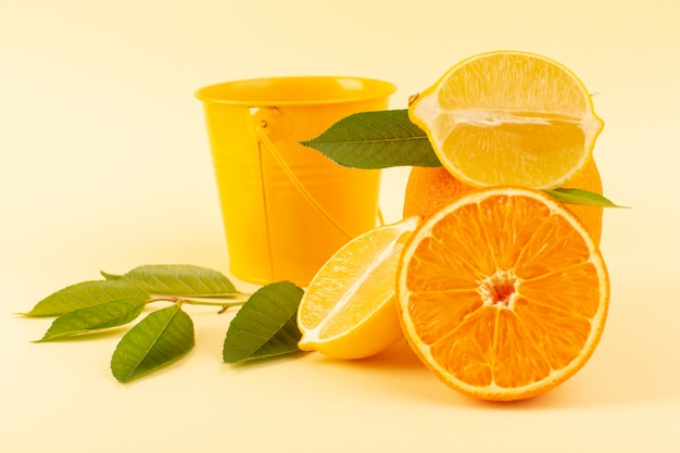 A front view whole orange and sliced piece along with sliced lemon ripe fresh juicy mellow isolated on the cream background citrus fruit orange