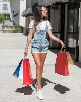 Front view woman carrying shopping bags