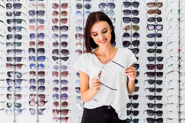 Front view of woman checking sunglasses