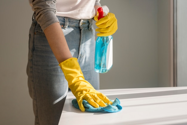 Front view of woman cleaning surface