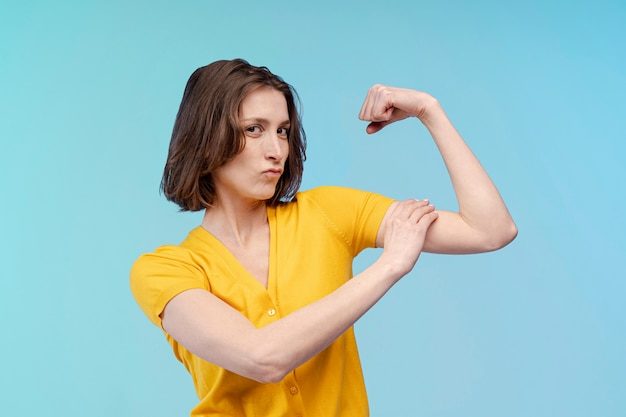 Front view of woman confident about her bicep