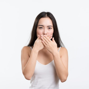 Front view woman covering mouth with hands