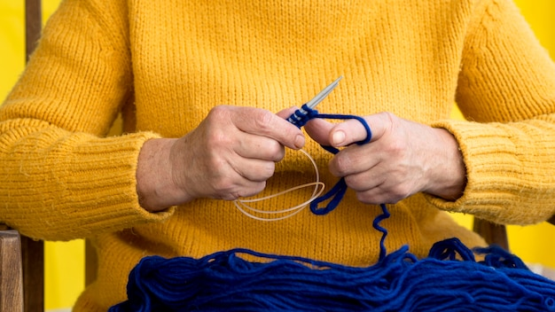 Front view of woman crocheting