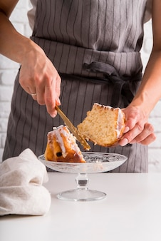 Front view woman cutting pound cake