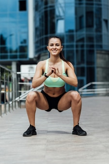 Front view of woman doing crouches