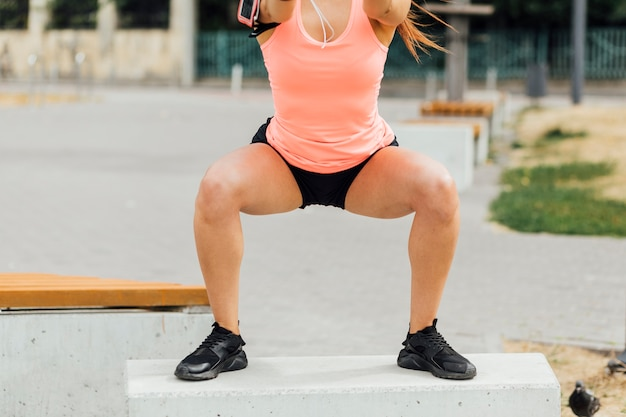 Front view of woman doing crouching exercises