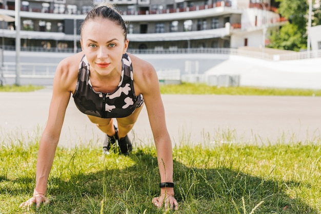 Front view of woman doing push-ups