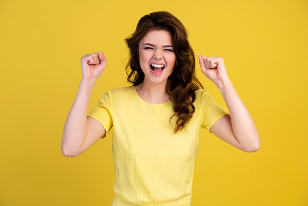Front view of woman excited about being a winner