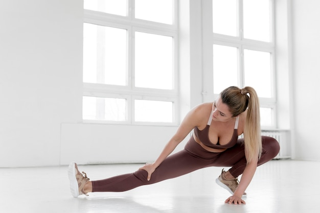 Front view of woman exercising