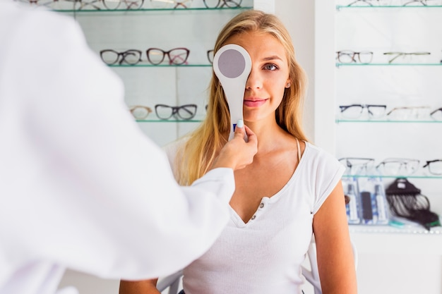 Front view of woman at eye exam