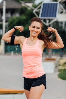 Front view of woman flexing her arms