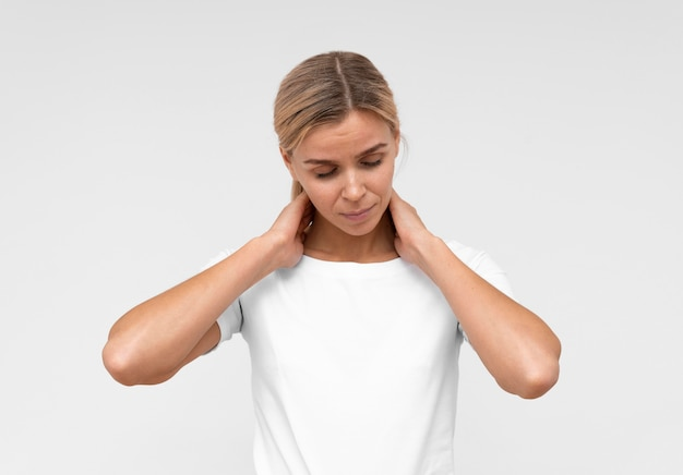 Front view of woman having neck pain