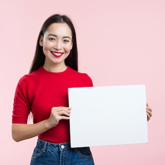Front view woman holding blank paper sheet