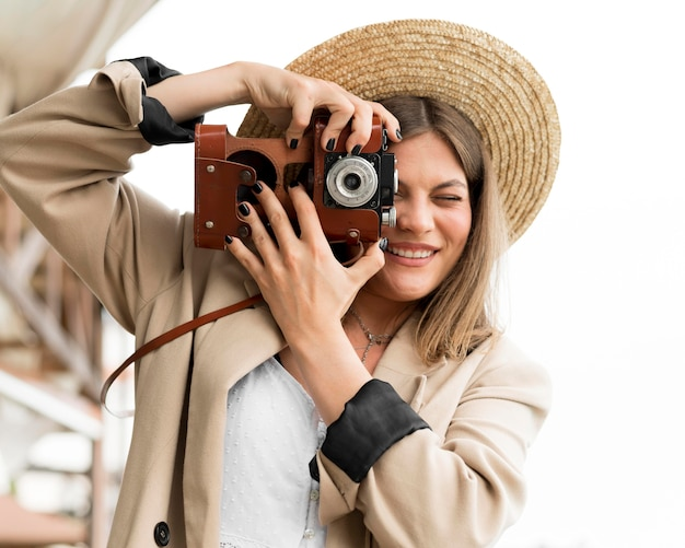Front view woman holding camera
