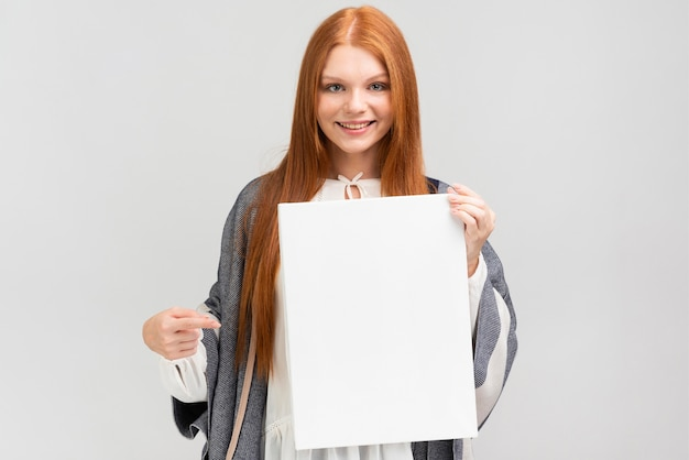 Front view woman holding canvas