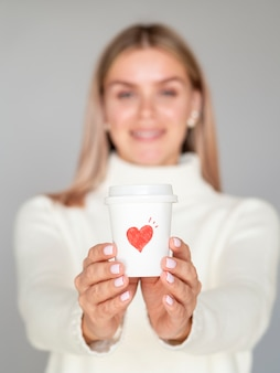 Front view woman holding coffee cup