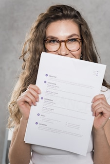 Front view of woman holding her resume